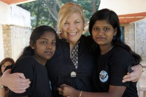 Janet with Shaping Futures children