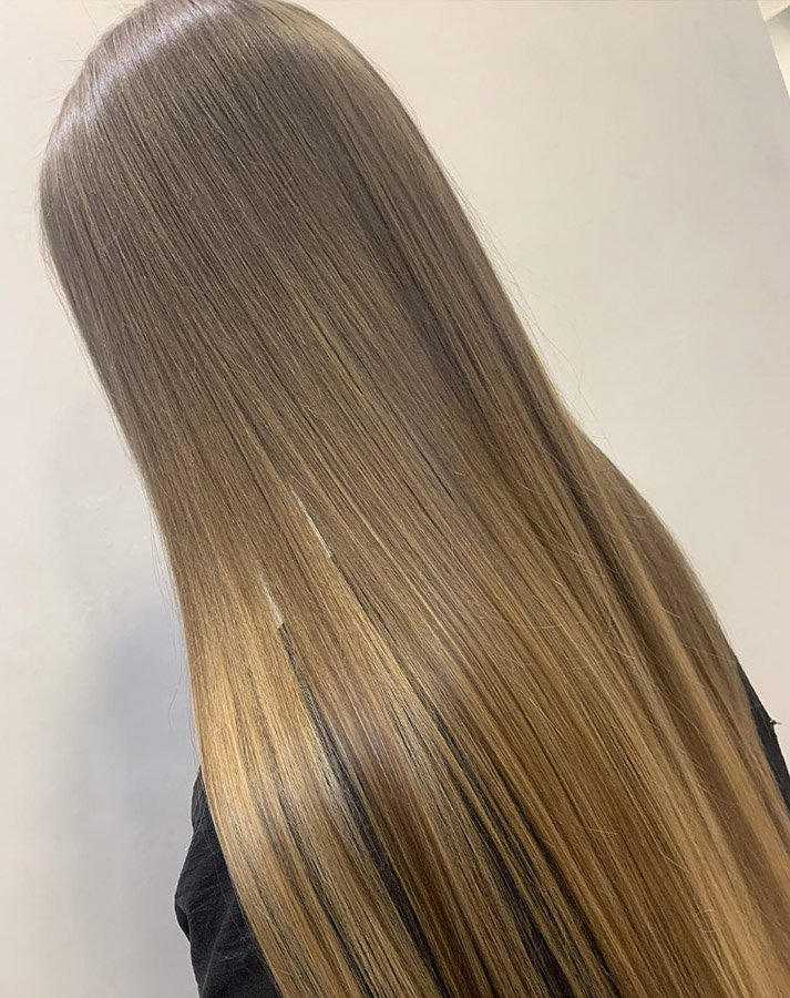 Super long, super shiny dark blonde hairstyle