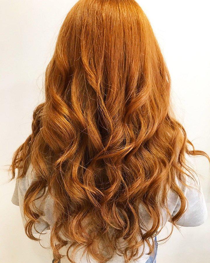 Firey copper long wavy hair