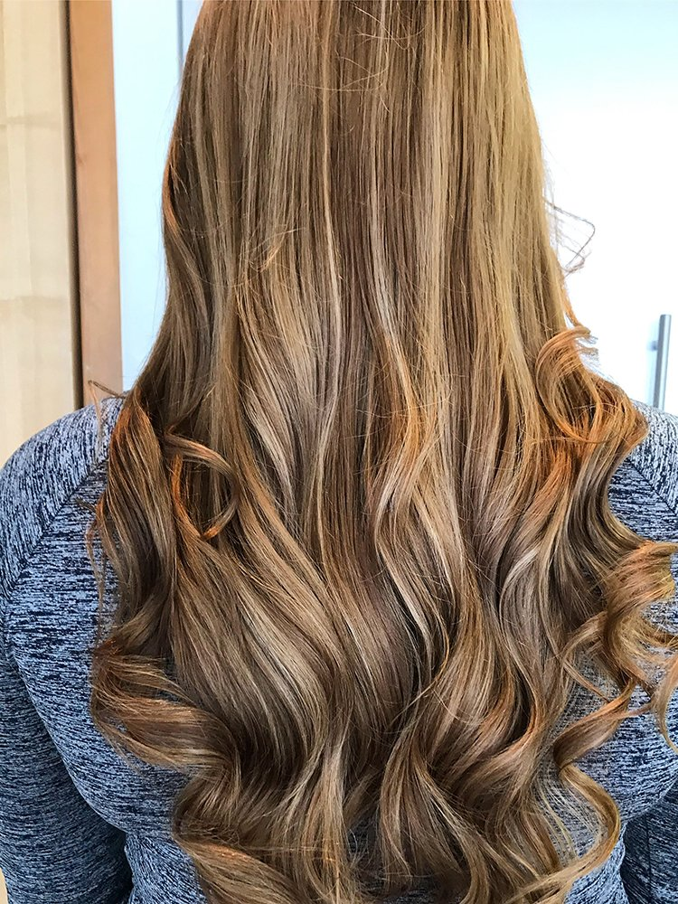 Long balayaged hair with a sunkissed effect