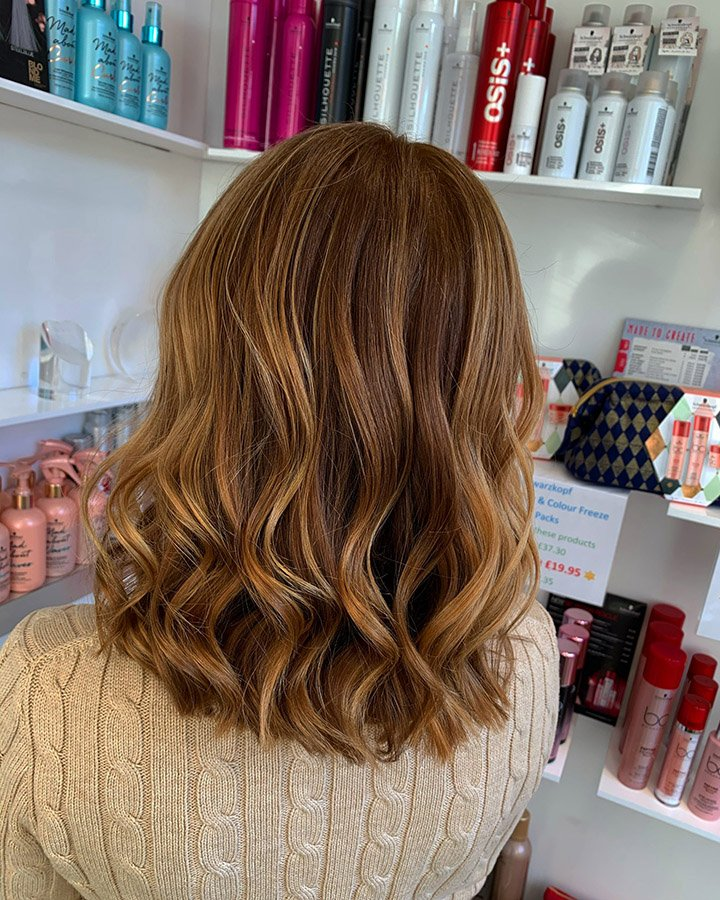 Copper toned lob hairstyle